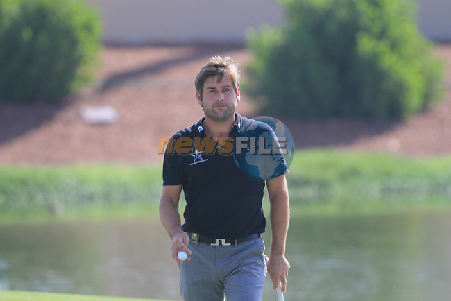 Robert Rock walks off the par3 17th green during Day 2 of the Dubai World Championship, Earth Course, Jumeirah Golf Estates, Dubai, 26th November 2010..(Picture Eoin Clarke/www.golffile.ie)