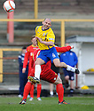 COWDENBEATH'S PLAYER MANAGER COLIN CAMERON IS CAUGHT LATE BY ALBION'S TONY STEVENSON