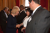 London, Uk. 15/10/2015. HRH The Duchess of Cornwall is introduced to the parents of Junior Winner Nathan Swain from Tristan da Cunha. The Duchess of Cornwall on behalf of Her Majesty The Queen, Patron of The Royal Commonwealth Society, holds a reception for winners of The Queen's Commonwealth Essay Competition at Buckingham Palace. The Queen's Commonwealth Essay Competition was founded in 1883 and is the world's oldest international schools' writing contest. This year's competition, sponsored by Cambridge University Press, received more than 13,000 entries from over 600 schools in 49 Commonwealth countries and territories. The Duchess of Cornwall hands out awards to young writers who have travelled from across the Commonwealth to attend the reception. This year's winners have come from Cyprus, Botswana, The Cayman Islands and as far away as Tristan da Cunha - over 9000km away.