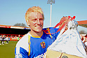 Mark Roberts of Stevenage Borough celebrates  winning promotion with a replica of the trophy after the Blue Square Premier match between Kidderminster Harriers and Stevenage Borough at the Aggborough Stadium, Kidderminster on Saturday 17th April, 2010..© Kevin Coleman 2010