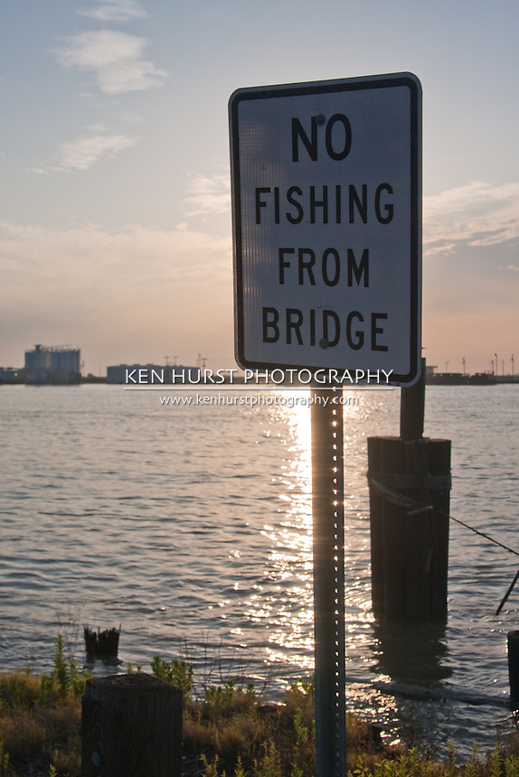 """Incongruous (and absurd) """"No Fishing From Bridge"""" sign where there is not a bridge at the ferry crossing the inlet to Calcasieu Lake from the Gulf of Mexico near Cameron, Louisiana."""