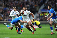Manu Tuilagi of England is tackled by Tommaso Allan of Italy during the Guinness Six Nations match between England and Italy at Twickenham Stadium on Saturday 9th March 2019 (Photo by Rob Munro/Stewart Communications)