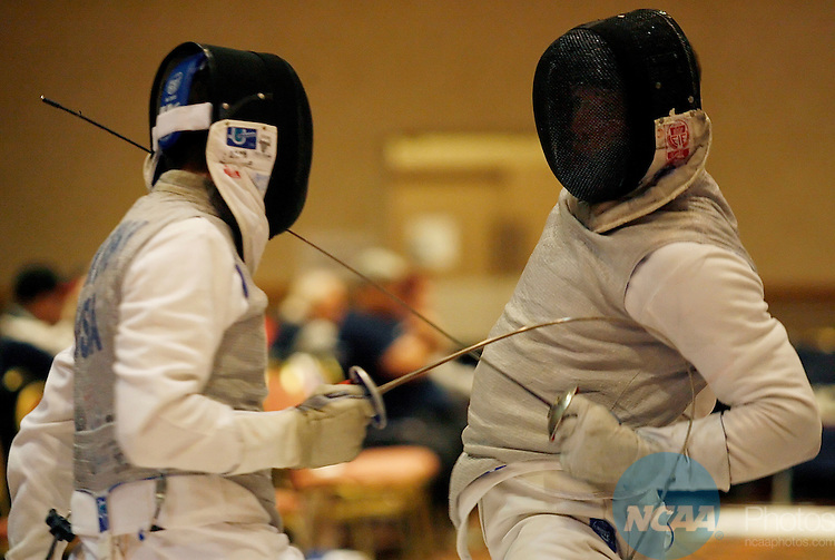17 MARCH 2006: Boaz Ellis of Ohio State, right, fences with Ron Berkowsky of Penn, left, during the Foil semifinals of the Division I Men's Fencing Championship held at the J.W. Marriott in Houston, TX. Ellis went on to win the national title in the event.  Dave Einsel/NCAA Photos