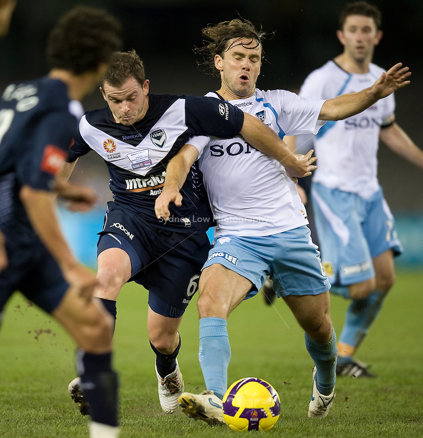 MELBOURNE, AUSTRALIA - MARCH 20, 2010: Leigh Broxham from Melbourne Victory pushes through for the ball in the final of the 2010 A-League between the Melbourne Victory and Sydney FC at Etihad Stadium on March 20, 2010 in Melbourne, Australia. Photo Sydney Low www.syd-low.com