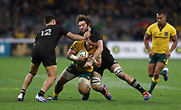 Tolu Latu of the Wallabies is tackled by Anton Lienert-Brown and Samuel Whitelock of the All Blacks during the Rugby Championship match between Australia and New Zealand at Optus Stadium in Perth, Australia on August 10, 2019 . Photo: Gary Day / Frozen In Motion