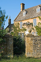 Grand house period property with dry stone wall near Winchcombe, Gloucestershire, The Cotswolds, England, United Kingdom