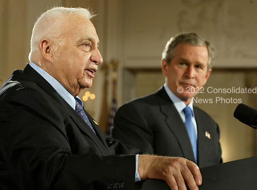 Prime Minister Ariel Sharon of Israel speaks during a news conference with United States President George W. Bush at the White House in Washington, DC. on April 14, 2004.  Bush announced he would support Israel's planned unilateral pullout from the Gaza Strip. <br /> Credit: Mark Wilson / Pool via CNP