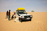 Chad (Tchad), North Africa, Sahara, Borkou District, Land Cruiser stuck in deep sand