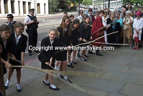 Beating the Bounds takes place annually on Ascension Day at All Hallows by the Tower. City of London, School children from St Dunstans College, Catford return to their roots to take part ion the preceedings.  Beating the Bounds in Lower Thames Street.