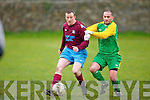 Camp United's David Clifford tackle's Spa Road's Shane Fitzgerald hard at Mounthawk park, Tralee on Sunday.