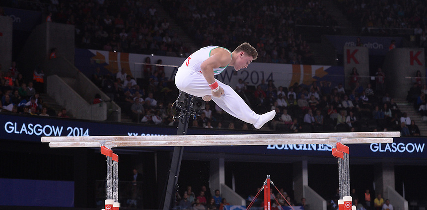 Wales' Iwan Mepham performs his routine on the parallel bars in the gymnastics artistic men's all-round final<br /> <br /> Photographer Chris Vaughan/CameraSport<br /> <br /> 20th Commonwealth Games - Day 7 - Wednesday 30th July 2014 - Gymnastics - The SSE Hydro - Glasgow - UK<br /> <br /> &copy; CameraSport - 43 Linden Ave. Countesthorpe. Leicester. England. LE8 5PG - Tel: +44 (0) 116 277 4147 - admin@camerasport.com - www.camerasport.com