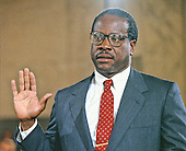 Judge Clarence Thomas is sworn-in to testify during the hearing before the US Senate Judiciary Committee to confirm him as Associate Justice of the US Supreme Court in the US Senate Caucus Room in Washington, DC on September 10, 1991.  Thomas was nominated for the position by US President George H.W. Bush on July 1, 1991 to replace retiring Justice Thurgood Marshall.<br /> Credit: Arnie Sachs / CNP