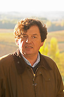 Comte (count) Laurent de Bosredon, owner of Chateau Belingard standing in front of his vineyard in autumn evening sunshine Chateau Belingard Bergerac Dordogne France