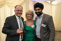Kevin & Carol Brennan of Brennans Pharmacy with Karambir Landa of PKF Cooper Parry