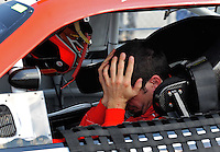 Oct 4, 2008; Talladega, AL, USA; NASCAR Sprint Cup Series driver Patrick Carpentier reacts after failing to qualify for the Amp Energy 500 at the Talladega Superspeedway. Mandatory Credit: Mark J. Rebilas-