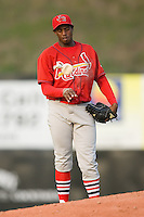 Relief pitcher Jose Mateo (31) of the Johnson City Cardinals gets some rosin on his pitching hand at Dan Daniels Park in Danville, VA, Sunday July 27, 2008.