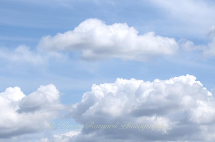 Billowy white clouds scudding across the Montana Big Sky