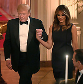 United States President Donald J. Trump (L) holds hands with First Lady Melania Trump after opening remarks at a White House Historical Association dinner at the White House, May 15, 2019, in Washington, DC. The organization's goal is to promote the public's understanding, appreciation and enjoyment of the White House.  <br /> Credit: Mike Theiler / Pool via CNP