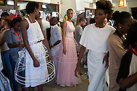 MAPUTO, MOZAMBIQUE – DECEMBER 10: Models wait backstage before a show at Mozambique fashion week held on December 10, 2015 in Maputo, Mozambique. The yearly event brings designers from Southern Africa and Portugal. (Photo by: Per-Anders Pettersson)