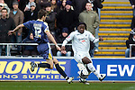 Coca-Cola Football League Championship - Swansea City v Cardiff City @ The Liberty Stadium in Swansea..Swansea's Jason Scotland (right) is tackled by Roger Johnson of Cardiff...