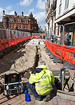 Male BT Openreach broadband technician working in town centre of Ipswich, Suffolk, England, UK
