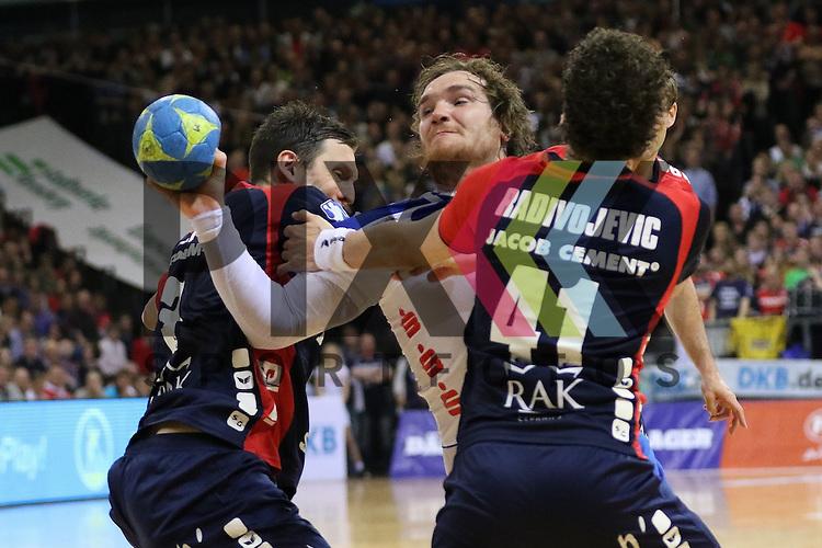 Flensburg, 16.05.2015, Sport, Handball, DKB Handball Bundesliga, Saison 2014/2015, SG Flensburg-Handewitt - TBV Lemgo : Tobias Karlsson (SG Flensburg-Handewitt, #03), Bogdan Radivojevic (SG Flensburg-Handewitt, #41) ,Timm Schneider (TBV Lemgo, #19)<br /> <br /> Foto &copy; P-I-X.org *** Foto ist honorarpflichtig! *** Auf Anfrage in hoeherer Qualitaet/Aufloesung. Belegexemplar erbeten. Veroeffentlichung ausschliesslich fuer journalistisch-publizistische Zwecke. For editorial use only.