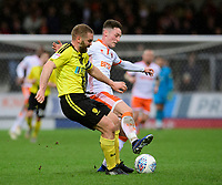 Blackpool's Jordan Thompson vies for possession with Burton Albion's Jake Buxton<br /> <br /> Photographer Chris Vaughan/CameraSport<br /> <br /> The EFL Sky Bet League One - Burton Albion v Blackpool - Saturday 16th March 2019 - Pirelli Stadium - Burton upon Trent<br /> <br /> World Copyright &copy; 2019 CameraSport. All rights reserved. 43 Linden Ave. Countesthorpe. Leicester. England. LE8 5PG - Tel: +44 (0) 116 277 4147 - admin@camerasport.com - www.camerasport.com
