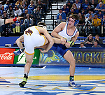 BROOKINGS, SD - JANUARY 18: Connor Brown from South Dakota State University controls the leg of Drake Foster from Wyoming during their 125 pound match Thursday night at Frost Arena in Brookings. (Photo by Dave Eggen/Inertia)