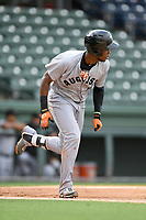 Shortstop Manuel Geraldo (26) of the Augusta GreenJackets runs out a batted ball in a game against the Greenville Drive on Wednesday, April 25, 2018, at Fluor Field at the West End in Greenville, South Carolina. Augusta won, 9-2. (Tom Priddy/Four Seam Images)