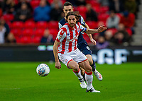 11th January 2020; Bet365 Stadium, Stoke, Staffordshire, England; English Championship Football, Stoke City versus Milwall FC; Joe Allen of Stoke City looks for the pass - Strictly Editorial Use Only. No use with unauthorized audio, video, data, fixture lists, club/league logos or 'live' services. Online in-match use limited to 120 images, no video emulation. No use in betting, games or single club/league/player publications