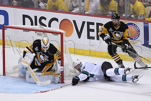 01.06.2016. Pittsburgh, Penn, USA.  San Jose Sharks center Tomas Hertl (48) puts a shot on Pittsburgh Penguins goalie Matt Murray (30) as he falls down during the second period in the 2016 NHL Stanley Cup Final - Game Two between the San Jose Sharks and the Pittsburgh Penguins at the Consol Energy Center in Pittsburgh, Pennsylvania.