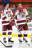 Michael Del Mauro (Harvard - 13), Chris Huxley (Harvard - 28) - The Harvard University Crimson defeated the St. Lawrence University Saints 4-3 on senior night Saturday, February 26, 2011, at Bright Hockey Center in Cambridge, Massachusetts.