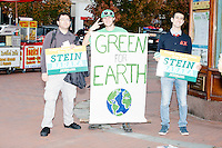 Stein supporters hold signs in Copley Square in Boston, Massachusetts, before a campaign rally for Green Party presidential nominee Jill Stein at Old South Church on Sun., Oct. 30, 2016.