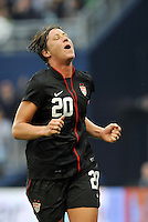 USWNT forward Abby Wambach (20) reacts to a near miss.