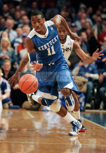 Freshman guard John Wall dribbles the ball down court in the first half of UK's game against UCONN at Madison Square Gardens in New York, NY. Photo by Britney McIntosh | Staff
