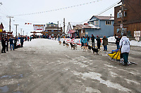 Rookie Tamara Rose arrives in the finish chute on Front Street in Nome during the 2010 Iditarod