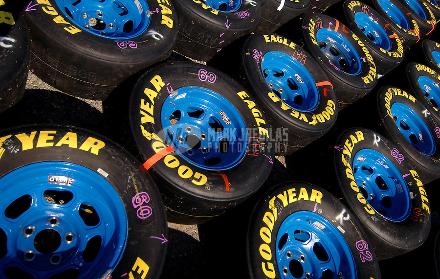 June 4, 2006; Dover, DE, USA; Tires from the car of Nascar Nextel Cup driver Ryan Newman (12) sit on pit road prior to the Neighborhood Excellence 400 at Dover International Speedway. Mandatory Credit: Mark J. Rebilas.