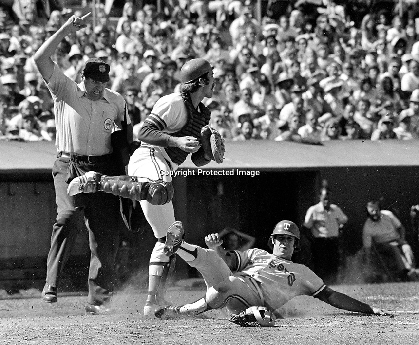 Oakland A's catcher Ray Fosse forces Texas Ranger runner out at home..(1975 photo/Ron Riesterer)
