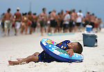 "A 2 year-old from Carrabelle, Florida takes a break from his Memorial Day weekend at the White Trash Bash on Dog Island off the coast of Carrabelle, Florida May 27, 2007.  ""We came over yesterday and camped out"" said his mother Niki Kennedy."