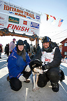 Friday March 16, 2007  - Nome, Alaska ----   Tom Lesatz and his girl friend and kennel partner Jessica Hendricks pose with their leader at the finish chute on Front street.