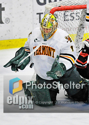 27 January 2012: University of Vermont Catamount goaltender John Vazzano, a Senior from Trumbull, CT, makes a third period save against the Northeastern University Huskies at Gutterson Fieldhouse in Burlington, Vermont. The Catamounts fell to the Huskies 8-3 in the first game of their 2-game Hockey East weekend series. Mandatory Credit: Ed Wolfstein Photo
