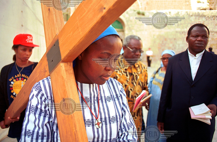 Nigerian Christian pilgrims arrive at the back entrance of the Church of the Holy Sepulchre in Jerusalem's old city, during Easter..
