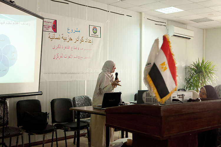 Dr Manal Abul Hassan, Professor of Media and Mass Communication and candidate for Egypt's Parliament 2011, gives a multimedia lecture to women in FJP headquarters in Downtown, Cairo. Egypt, October 2012.