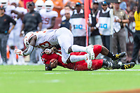 Landover, MD - September 1, 2018: Texas Longhorns wide receiver Jerrod Heard (13) is flagged for targeting after this hit on Maryland Terrapins quarterback Kasim Hill (11) during game between Maryland and No. 23 ranked Texas at FedEx Field in Landover, MD. The Terrapins upset the Longhorns in back to back season openers with a 34-29 win. (Photo by Phillip Peters/Media Images International)