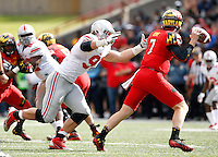 Ohio State Buckeyes defensive lineman Joey Bosa (97) chases down Maryland Terrapins quarterback Caleb Rowe (7) during the fourth quarter of the NCAA football game at Byrd Stadium in College Park, Maryland on Oct. 4, 2014. (Adam Cairns / The Columbus Dispatch)