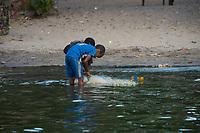 Africa, Madagascar, Canal des Pangalanes. Aye Aye Island. Children fishing at Palmarium Bungalow.
