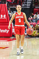 College Park, MD - March 23, 2019: Radford Highlanders guard Jen Falconer (5) dribbles the ball during game between Radford and Maryland at  Xfinity Center in College Park, MD.  (Photo by Elliott Brown/Media Images International)