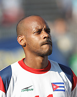 Cuban midfielder Ariel Martinez (11). In CONCACAF Gold Cup Group Stage, the national team of Cuba (white) defeated national team of Belize (red), 4-0, at Rentschler Field, East Hartford, CT on July 16, 2013.