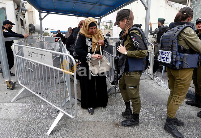 Palestinians make their way through an Israeli checkpoint to attend the second Friday prayer of the holy fasting month of Ramadan in Jerusalem's Al-Aqsa mosque, in Bethlehem in the occupied West Bank, on May 25, 2018. Ramadan is sacred to Muslims because it is during that month that tradition says the Koran was revealed to the Prophet Mohammed. The fast is one of the five main religious obligations under Islam. Muslims around the world will mark the month, during which believers abstain from eating, drinking, smoking and having sex from dawn until sunset. Photo by Wisam Hashlamoun