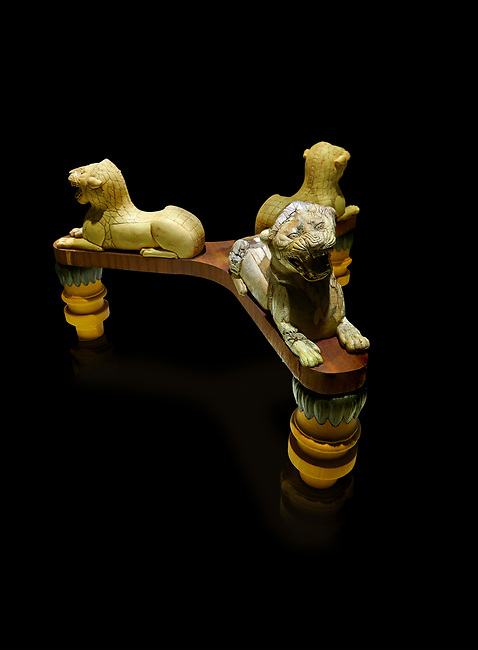 Phrygian table base support decorated with ivory roaring lion statuettes. From Gordion. Phrygian Collection, 8th-7th century BC - Museum of Anatolian Civilisations Ankara. Turkey. Against a black background